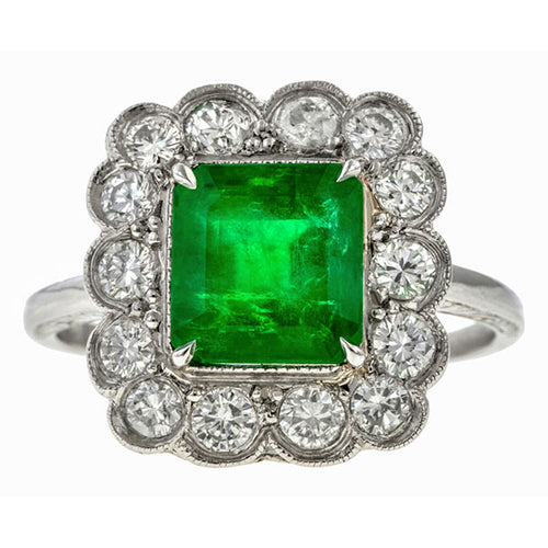 Vintage ring: a Platinum Emerald Cut Emerald Ring sold by Doyle & Doyle vintage and antique jewelry boutique.