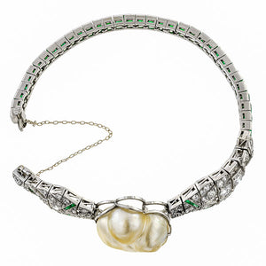 Art Deco bracelet: a Platinum Natural Pearl, Emerald And Diamond Bracelet sold by Doyle & Doyle vintage and antique jewelry boutique.