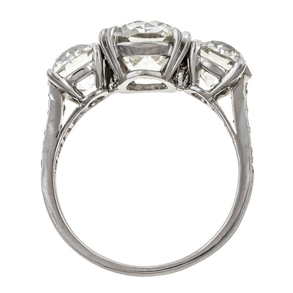 Vintage ring: a Platinum Three Stone Old European Cut Engagement Ring sold by Doyle & Doyle vintage and antique jewelry boutique.