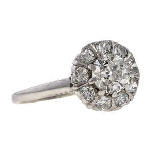 Vintage ring: a Platinum Diamond Cluster Old European Cut Engagement Ring sold by Doyle & Doyle vintage and antique jewelry boutique.