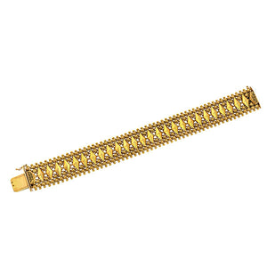 Retro bracelet: a Yellow Gold Textured Floral Motif Bracelet sold by Doyle & Doyle vintage and antique jewelry boutique.
