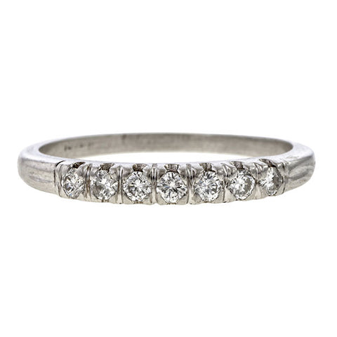 Vintage ring: a Platinum Round Brilliant Cut Diamond Wedding Band sold by Doyle & Doyle vintage and antique jewelry boutique.