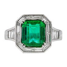 Estate ring: a Platinum Tiffany & Co. Emerald & Diamond Engagement Ring sold by Doyle & Doyle vintage and antique jewelry boutique.