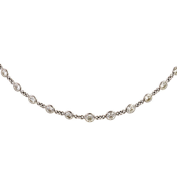 Diamond Necklace: a White Gold Round Brilliant Cut Diamond Necklace sold by Doyle & Doyle vintage and antique jewelry boutique.