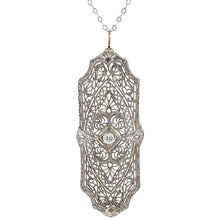 Vintage necklace: a Platinum Filigree Diamond Pendant sold by Doyle & Doyle vintage and antique jewelry boutique.