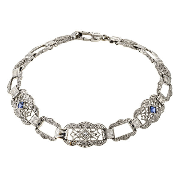 A Vintage Filigree Diamond and Sapphire Bracelet sold by Doyle & Doyle a antique and vintage jewelry boutique.