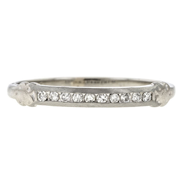 Vintage ring: a Diamond Wedding Band sold by Doyle & Doyle vintage and antique jewelry boutique.