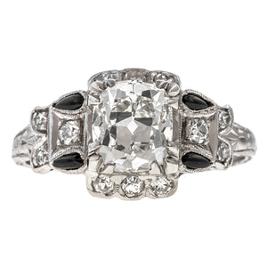 Art Deco ring: a Platinum Modified Brilliant Cut Diamond Engagement Ring sold by Doyle & Doyle vintage and antique jewelry boutique.