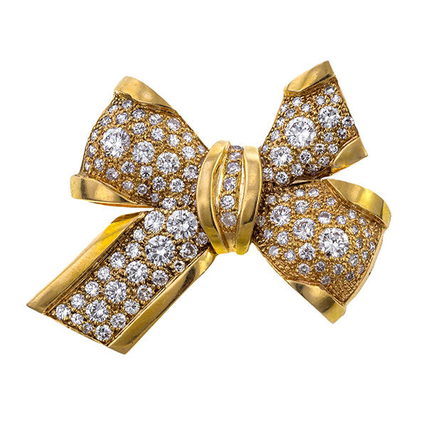 Estate Diamond Bow Pin sold by Doyle & Doyle vintage and antique jewelry boutique