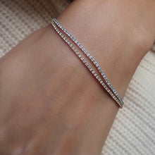 Skinny diamond tennis bracelet from Doyle & Doyle, an antique and vintage jewelry boutique.