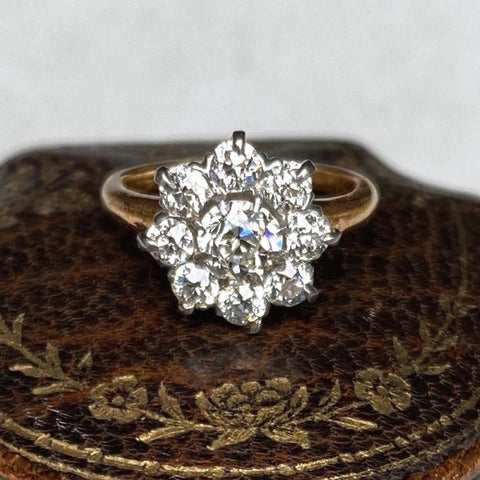 Antique diamond cluster ring in gold, from Doyle & Doyle.