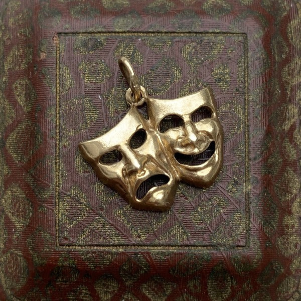 Vintage Comedy & Tragedy Mask Charm Pendant sold by Doyle & Doyle an antique and vintage jewelry boutique.