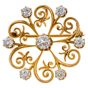 Antique Diamond Pinwheel Brooch sold by Doyle and Doyle an antique and vintage jewelry boutique