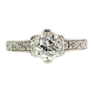 Contemporary ring: a Platinum Flower Shaped Old European Cut Diamond Heirloom Engagement Ring sold by Doyle & Doyle vintage and antique jewelry boutique.