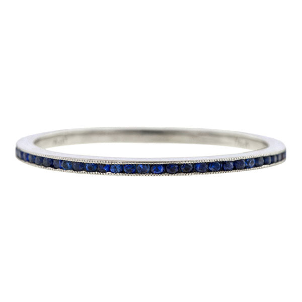 Contemporary ring: a Platinum Sapphire Eternity Wedding Band sold by Doyle & Doyle vintage and antique jewelry boutique.