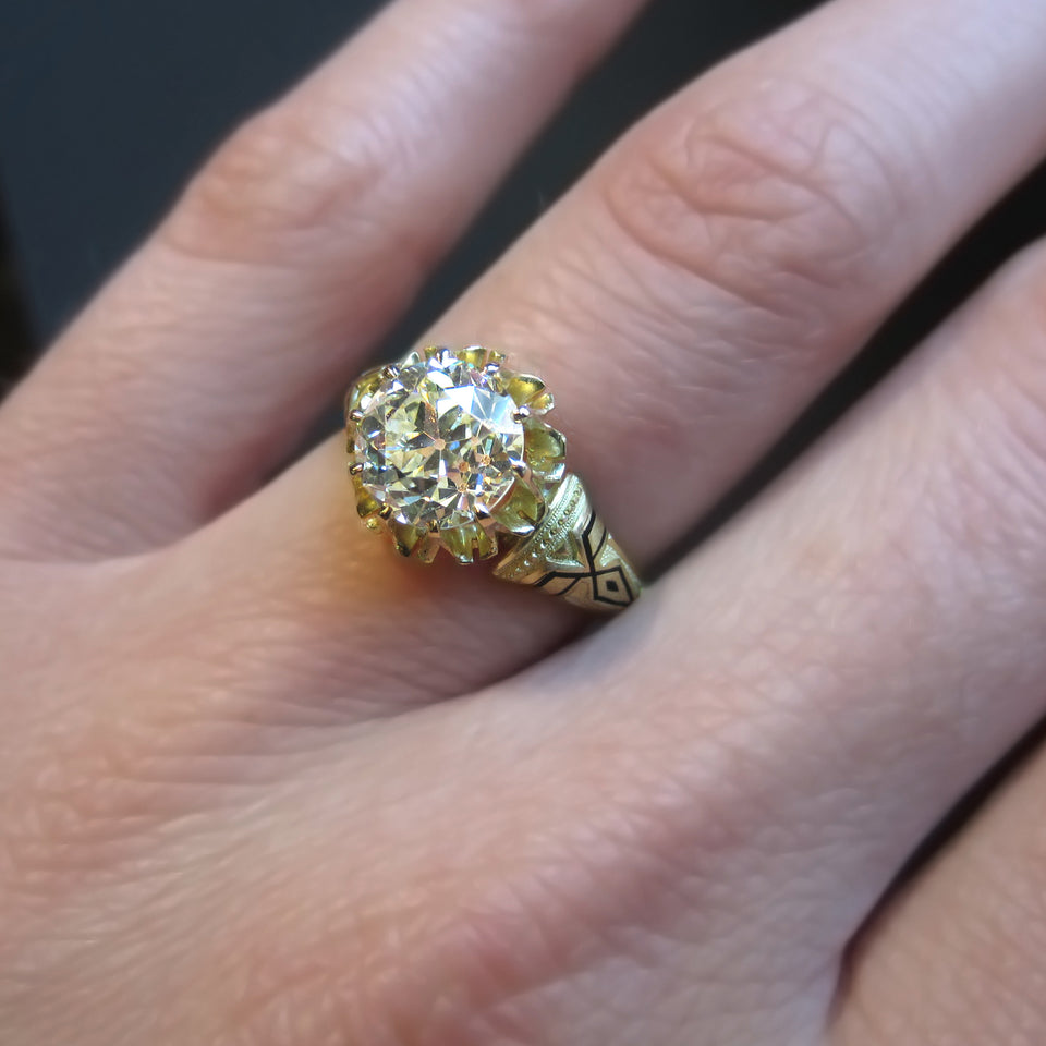 Victorian ring: a Yellow Gold Old European Cut Diamond Solitaire Engagement Ring sold by Doyle & Doyle vintage and antique jewelry boutique.