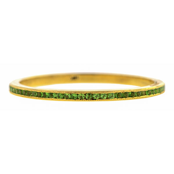 Contemporary ring; a Yellow Gold Tsavorite Wedding Eternity Band sold by Doyle & Doyle vintage and antique jewelry boutique.