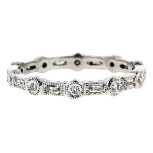 Contemporary ring: a Platinum Bezel Set Round & French Cut Diamond Band sold by Doyle & Doyle vintage and antique jewelry boutique.