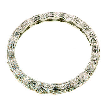 Contemporary ring; a Platinum Rope Pattern Diamond Eternity Wedding Band sold by Doyle & Doyle vintage and antique jewelry boutique.
