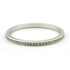 Contemporary ring: a Platinum Channel Set Diamond Eternity Wedding Band sold by Doyle & Doyle vintage and antique jewelry boutique.