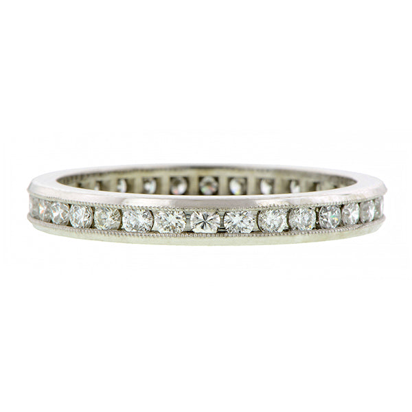 Contemporary ring; a Platinum Channel Set Round Brilliant Cut Diamond Eternity Band sold by Doyle & Doyle vintage and antique jewelry boutique.