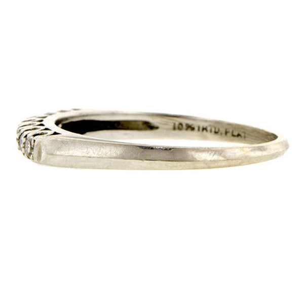 Vintage ring: a Platinum Diamond Wedding Band sold by Doyle & Doyle vintage and antique jewelry boutique.