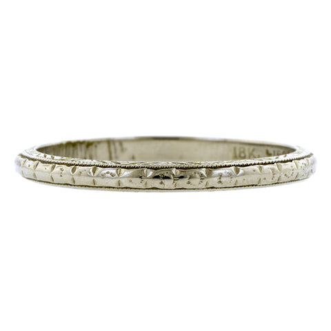 Vintage ring: a White Gold Patterned Wedding Band sold by Doyle & Doyle vintage and antique jewelry boutique.