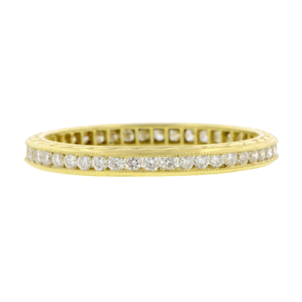 Contemporary ring: a Yellow Gold Channel Set Diamond Eternity Wedding Band sold by Doyle & Doyle vintage and antique jewelry boutique.