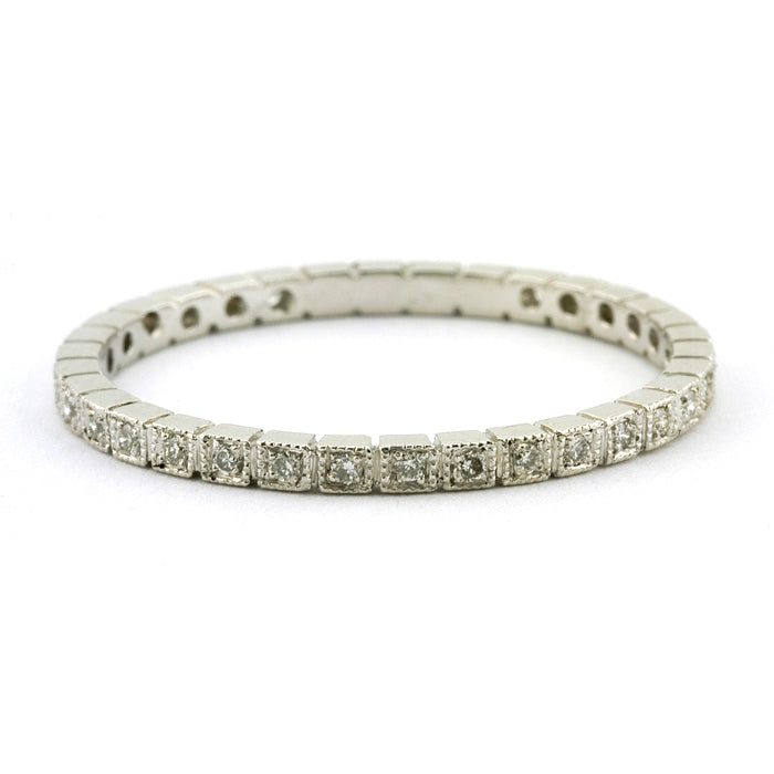 Contemporary ring: a Platinum Square Pattern Diamond Eternity Wedding Band sold by Doyle & Doyle vintage and antique jewelry boutique.