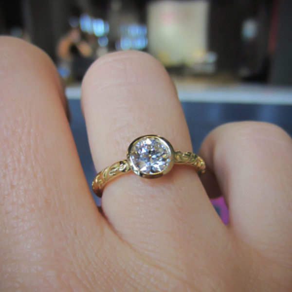 Contemporary ring: a Yellow Gold Bezel Set Old European Cut Diamond Solitaire Heirloom Engagement Ring sold by Doyle & Doyle vintage and antique jewelry boutique.