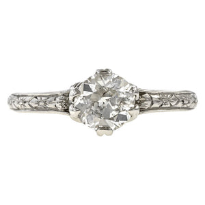 Contemporary ring; a Platinum Flower Engagement Ring, Old Euro 0.74ct sold by Doyle & Doyle vintage and antique jewelry boutique.