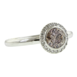 Contemporary ring: a White Gold Diamond Framed Purplish Pink Round Brilliant Cut Diamond 0.66ct Engagement Ring - Heirloom sold by Doyle & Doyle vintage and antique jewelry boutique.