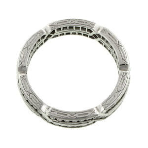 Contemporary ring: a Platinum Geometric Crossover Round Brilliant Cut Diamond Eternity Band sold by Doyle & Doyle vintage and antique jewelry boutique.