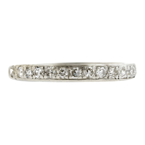 Vintage Diamond Wedding Bandmeasuring app. 2.6mm at widest, bead set with fourteen Single cut diamonds weighing app. 0.28ctw., with light engraving on sides, fashioned in platinum. Circa 1950. Size 6.25
