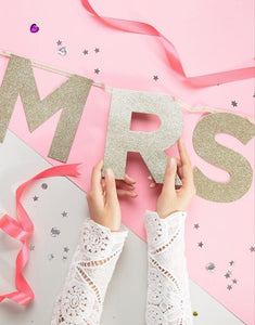 Add some glitzy glamour to your hens night with our sparkly gold glitter FROM MISS TO MRS party banner.