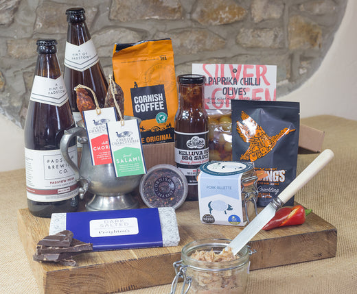 Our Ultimate Foodie Gift Hamper is the king of all food hampers. This carefully curated collection of delicious, artisan food and drink will put a smile on every food lover's face.