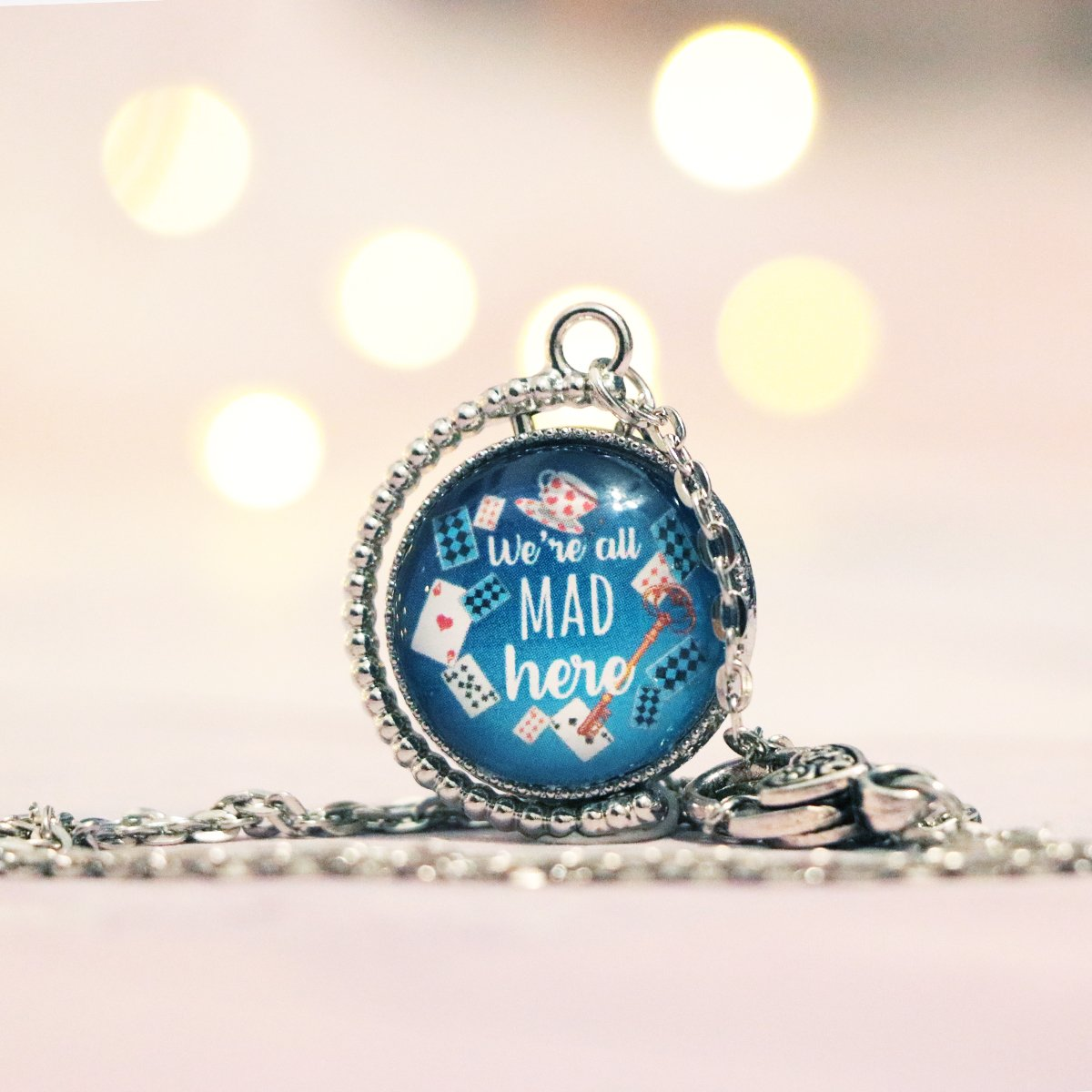 "Alice in Wonderland ""We're All Mad Here"" Double Sided Necklace"
