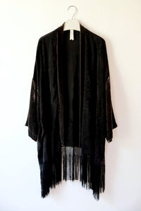 Black silk embroidered kimono with velvet sleeves and fringe hem, made from an antique piano shawl.  One-of-a-kind sustainable fashion.