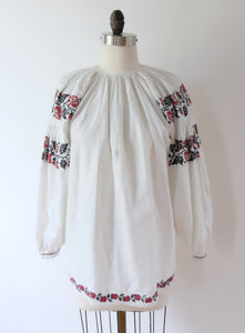 Hand embroidered vintage Ukrainian folk blouse with gathers at the neck and detail at the sleeve.