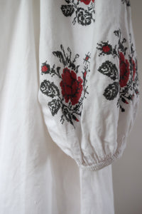 Vintage Ukrainian cotton dress with hand embroidered roses on the sleeves