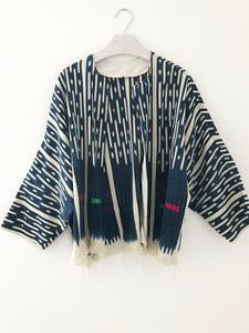 One-of-a-kind jacket made from a vintage ikat indigo African mud cloth with fringe hem