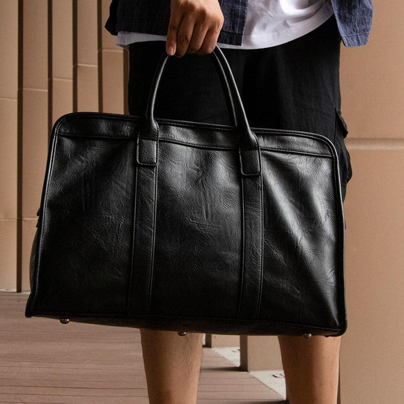 Faux leather holdall black 4919