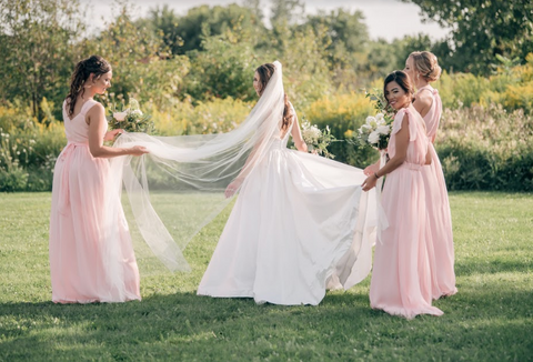 how to help the bride find her wedding gown. Pink bridesmaid dresses