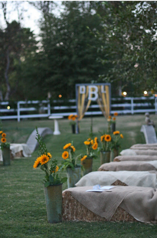 hay bale seating at wedding ceremony