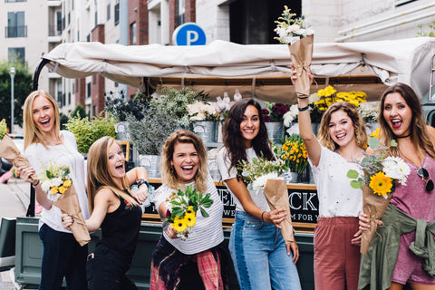 Bachelorette party survival guide: girls with sunflowers