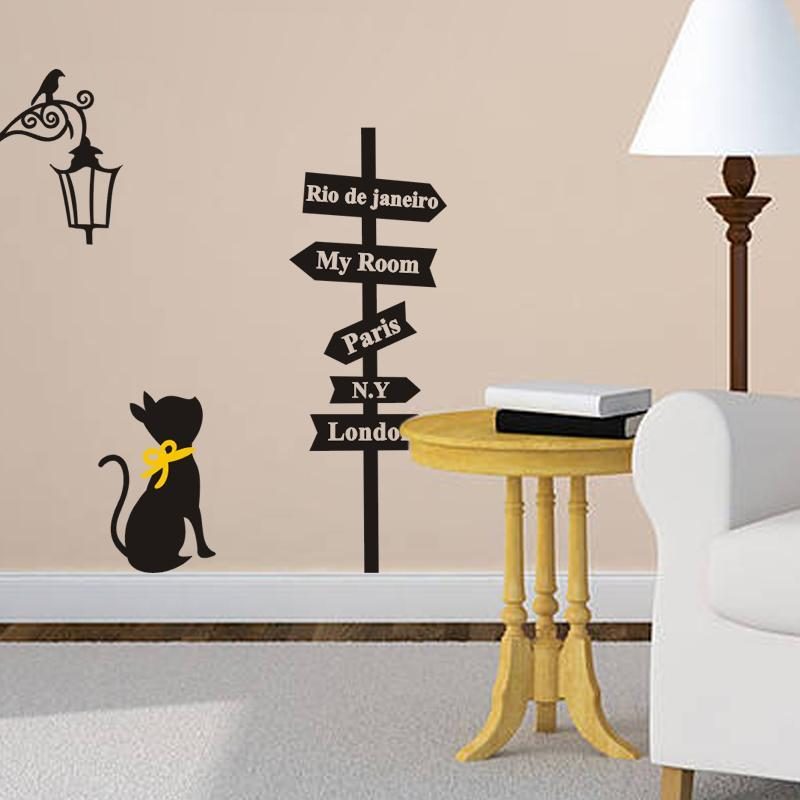cutecatslovers Creative Cities Sign with Cat and Bird on The Lamp