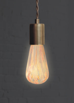 Decorative floral print light bulb with light turned on