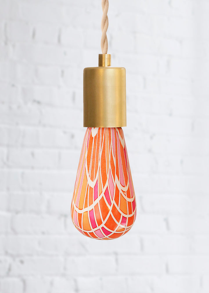 Pink and orange geometric decorative light bulb turned off