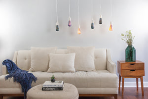 Space light bulbs in bright decorative living room