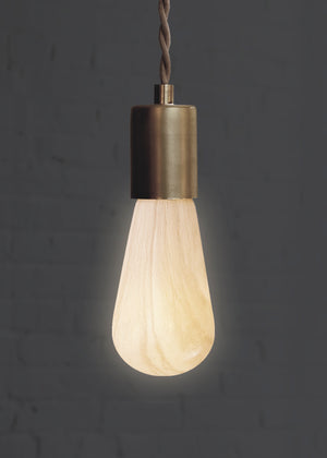 Marble Light Bulb for modern lighting design turned on